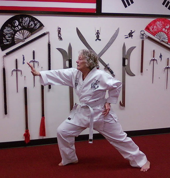 Woman with a white belt doing Tai Chi